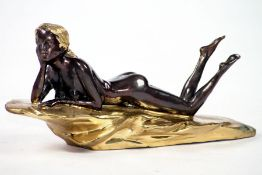 Lying nude female, bronze, brown and dark brown patinated, indicated rock and hair polished