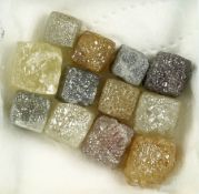 Lot 12 loose cubes-rough diamonds total approx. 14.89 ct , in different sizes and colours