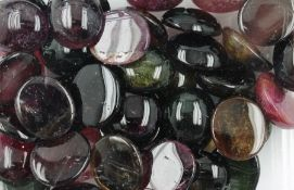 Lot loose tourmaline-cabochons total approx. 505 ct , different colours, predominant oval,