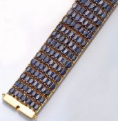 14 kt gold bracelet with sapphires , YG 585/000, approx. 1950/60s, 217 oval bevelled sapphires total