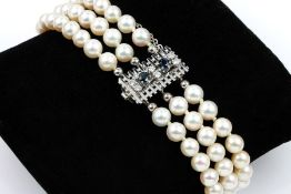 3-rowed bracelet made of cultured akoya pearls , clasp WG 585/000, 2 round bevelled sapphires