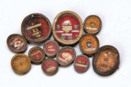 12 relics, Southern Germany, 19th c., all hand lettered, H. 2.4 -6 cm minor damages of age12