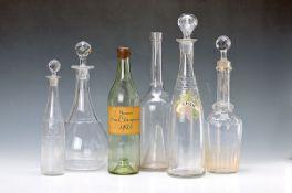 11 Flaschen/Karaffen, Frankreich, um 1880/ 1900, farbloses Glas, teilweise facettiert bzw.