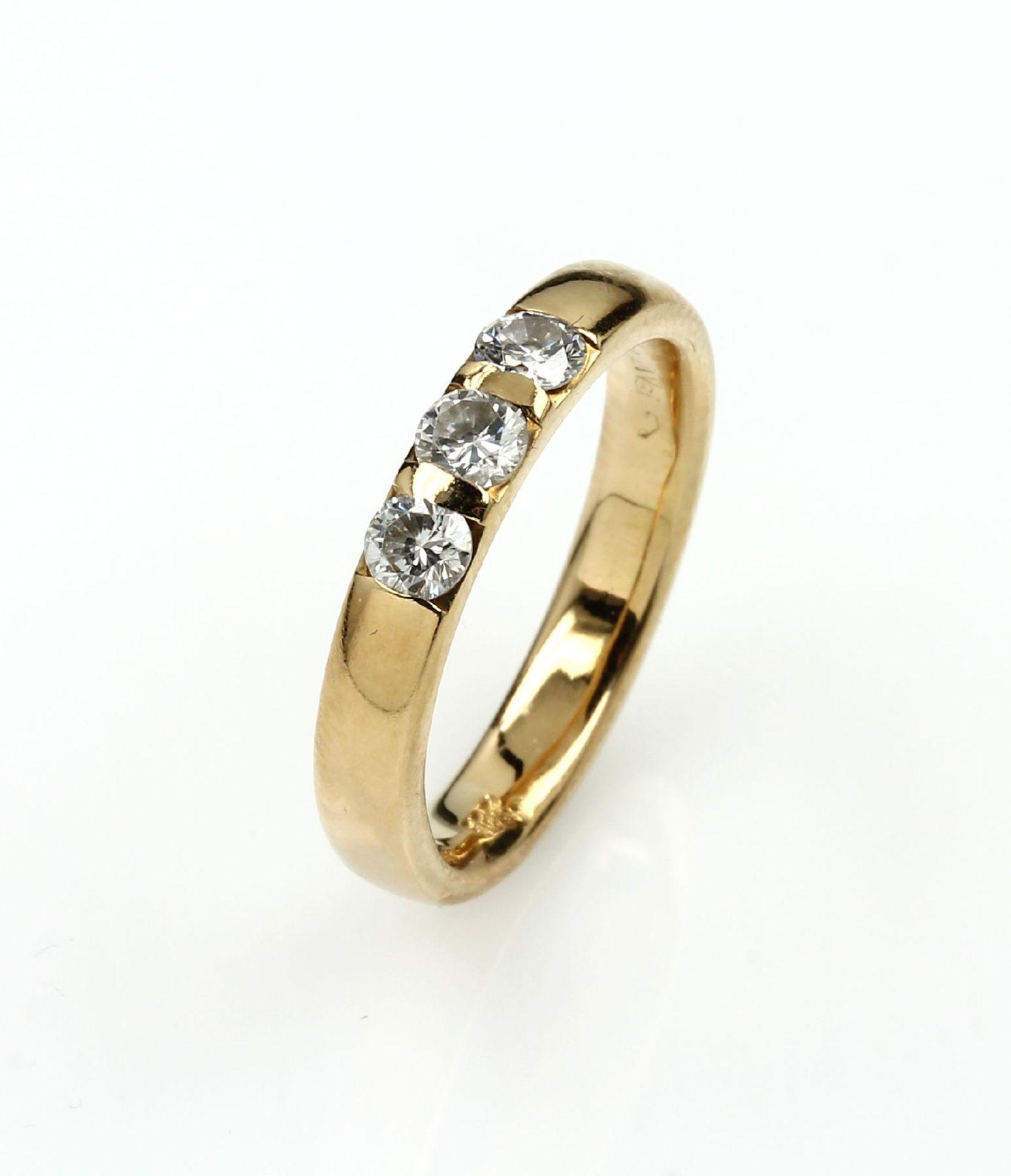 14 kt Gold Ring mit Brillanten, GG 585/000,3 Brillanten zus. ca. 0.42 ct Weiß/si (grav.),