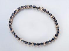 14 kt Gold Armband mit Farbsteinen und Brillanten, GG 585/000, 33 ovalfacett. Saphire zus. ca. 15.