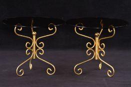 2 Bestelltische, Metallgestell, z.T. Schmiedearbeit, goldfarben gefasst, symmetrischer Ausbau,