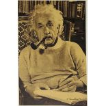 EINSTEIN ALBERT. 1879-1955. Portrait with autograph. - Magazine cutout, signed and [...]