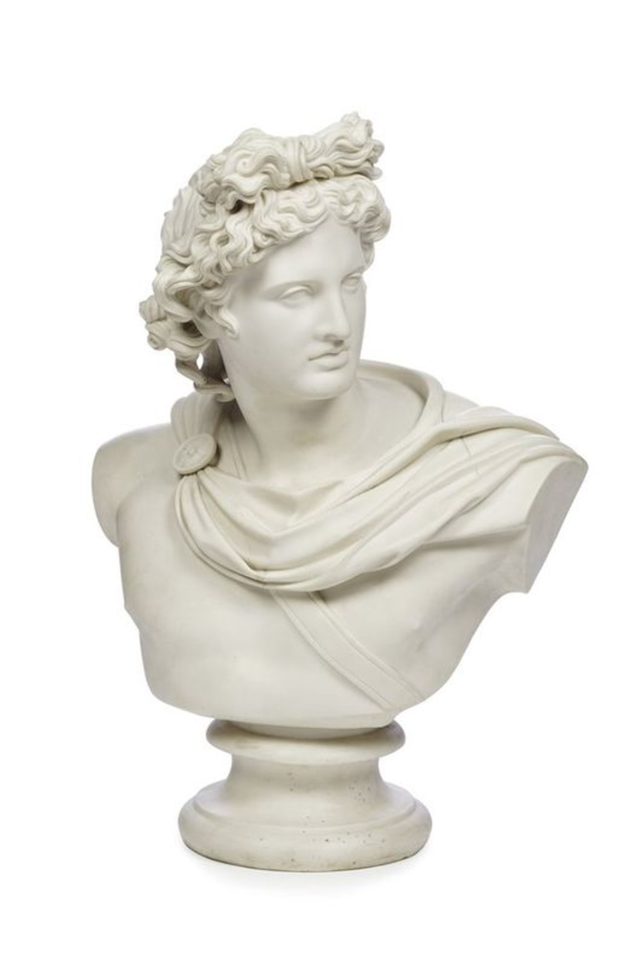 A PARIAN BUST OF APOLLO 19TH CENTURY - Modelled quarter-length, his head turned to [...]