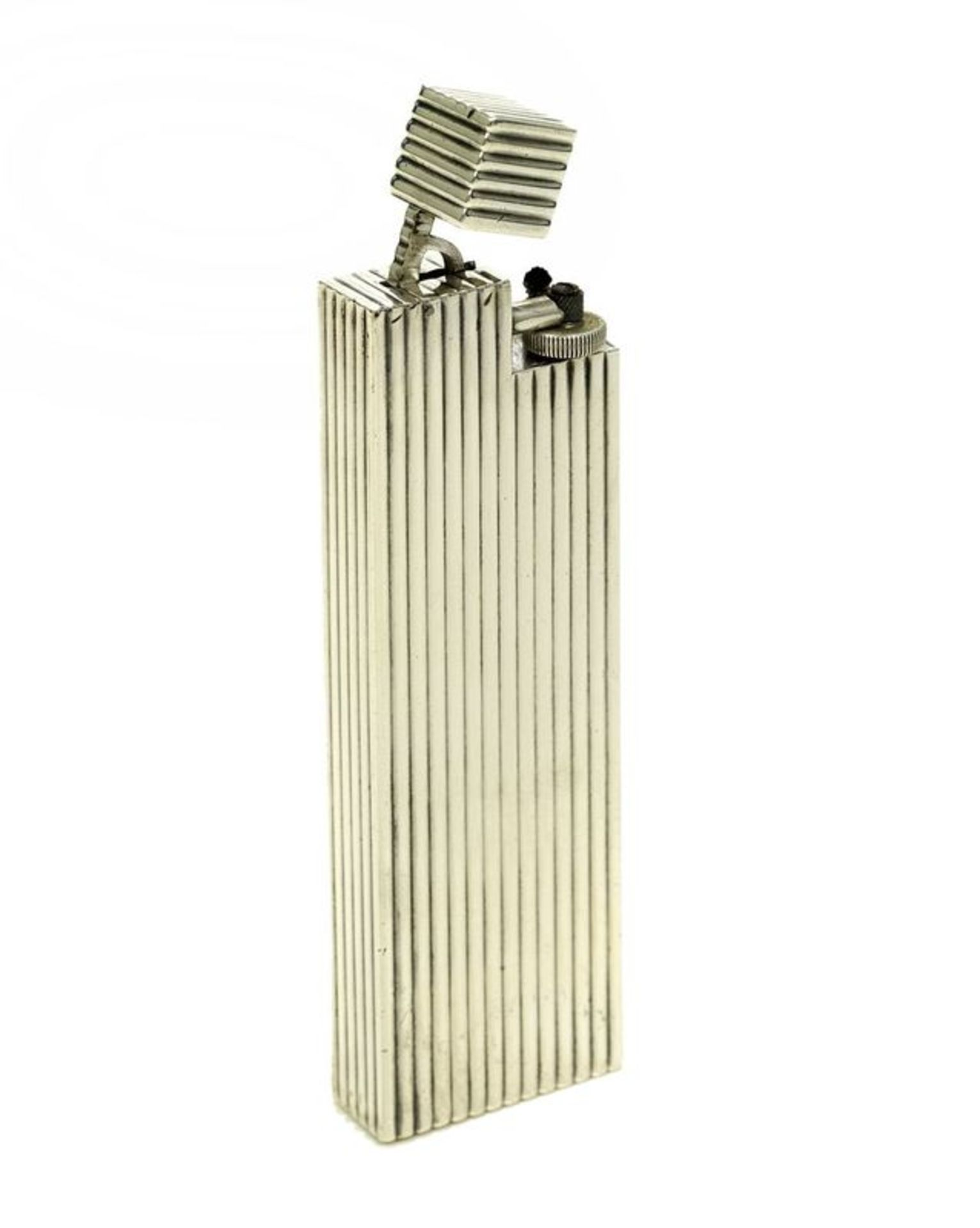 Reeded silver table lighter, Cartier - Signed Cartier Paris, French [...]