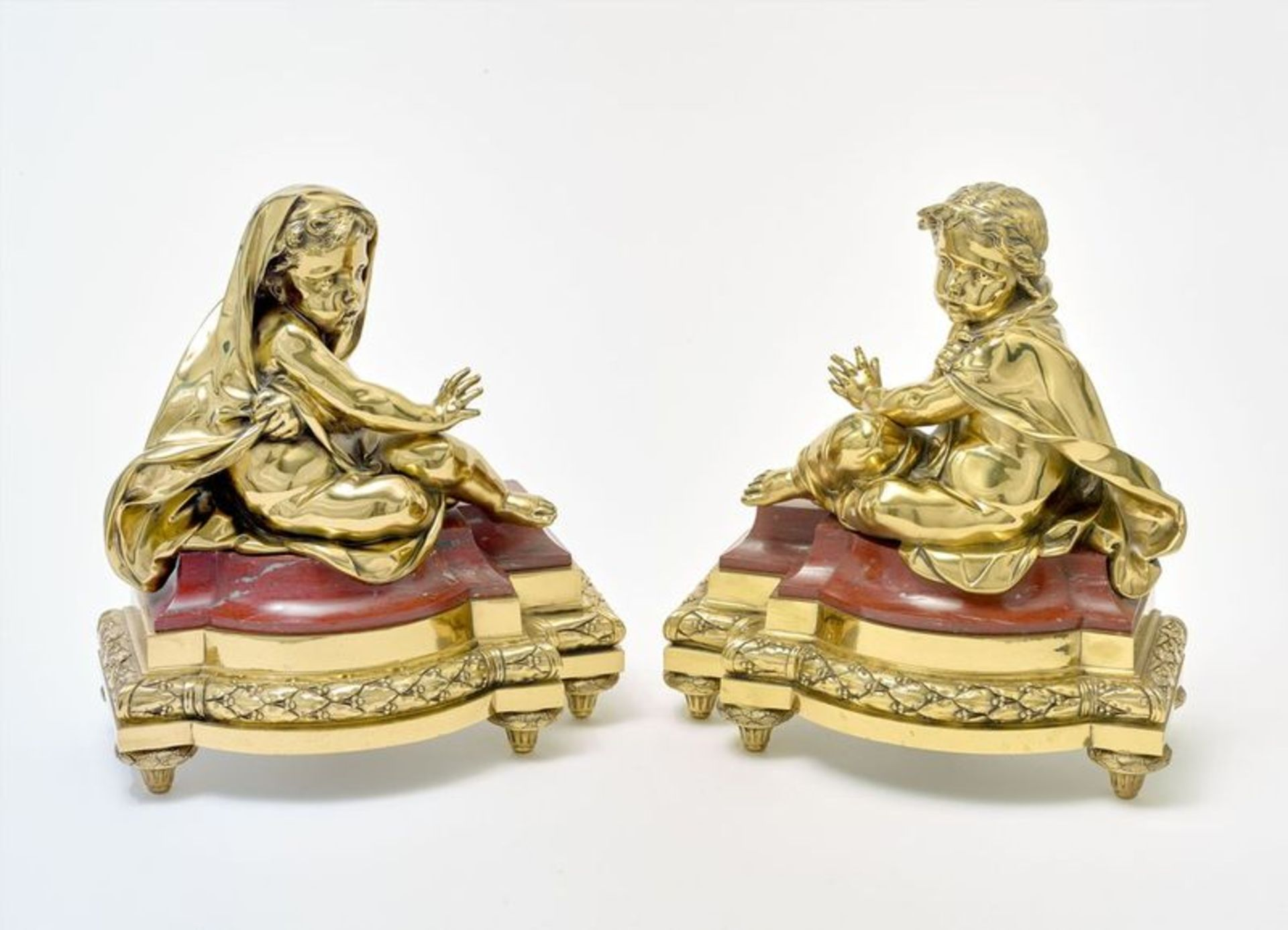 PAIR OF GUILTED BRONZE AND MARBLE FRENCH CHENETS, 19th century - They display a boy [...]