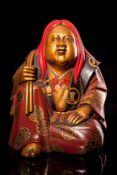 A Japanese Gilt Lacquered figure of Otafuku