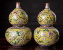 A Pair of Yellow-Ground Famille Rose Double Gourd Vases