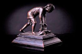 A Bronze Figure of a Farmer