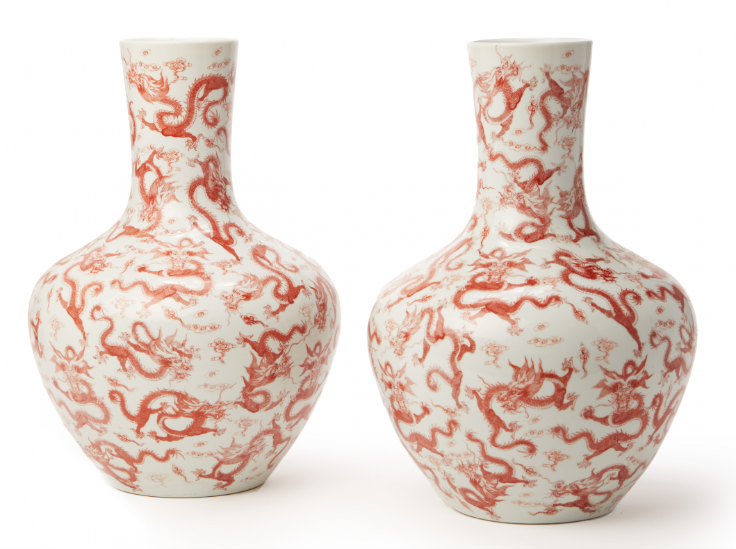 Lot 28 - A PAIR OF LARGE IRON RED DRAGON VASES