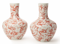 A PAIR OF LARGE IRON RED DRAGON VASES