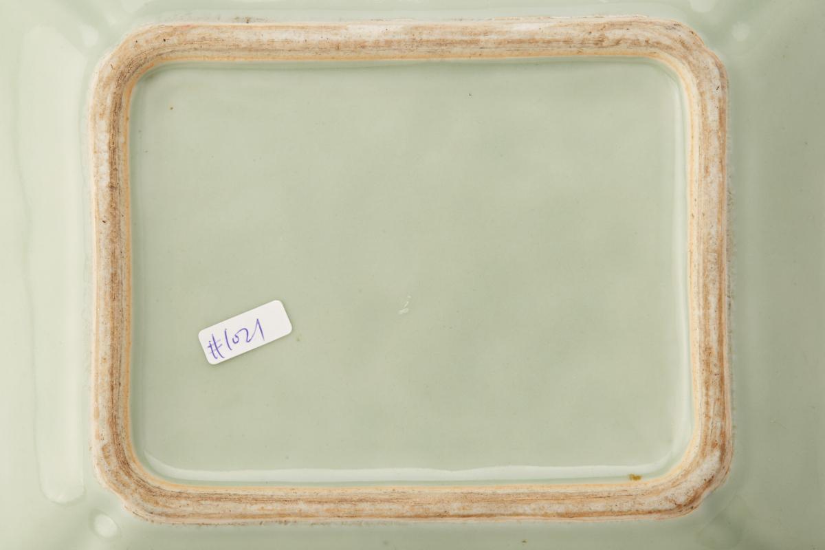 Lot 17 - A CELADON GROUND FAMILLE ROSE RECTANGULAR DISH