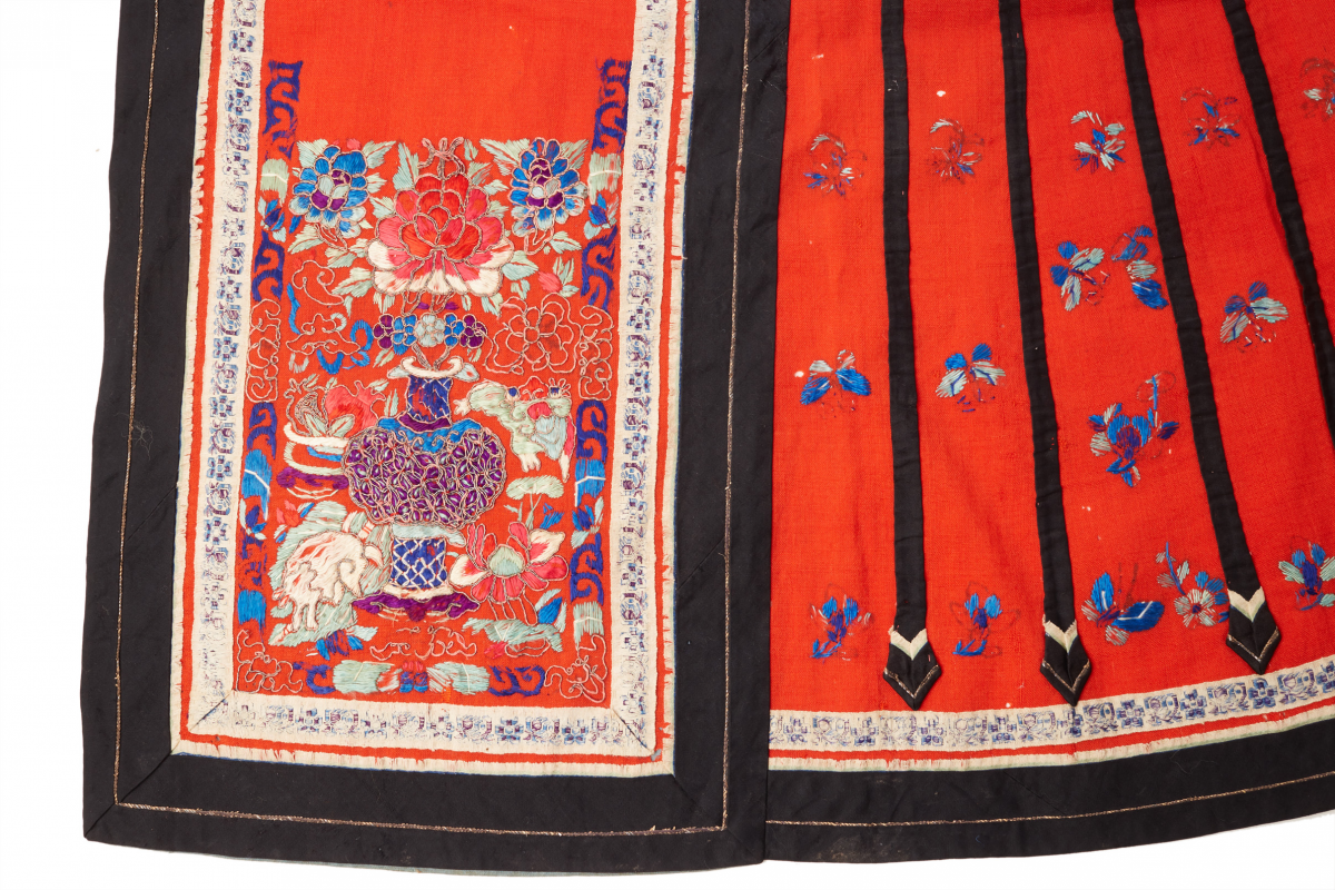 Lot 39 - A CHINESE EMBROIDERED RED SKIRT