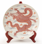 A LARGE IRON RED DRAGON DISH