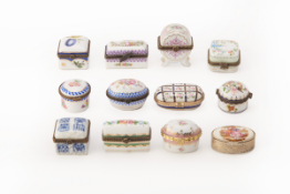 A GROUP OF TWELVE PORCELAIN PILL BOXES