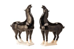 A PAIR OF CHINESE TANG STYLE BLACK GLAZED MODELS OF HORSES