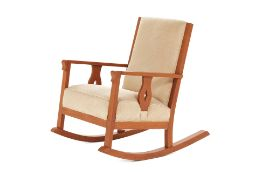 AN UPHOLSTERED TEAK ROCKING CHAIR