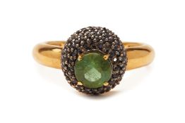 A GREEN TOURMALINE AND BLACK SAPPHIRE RING