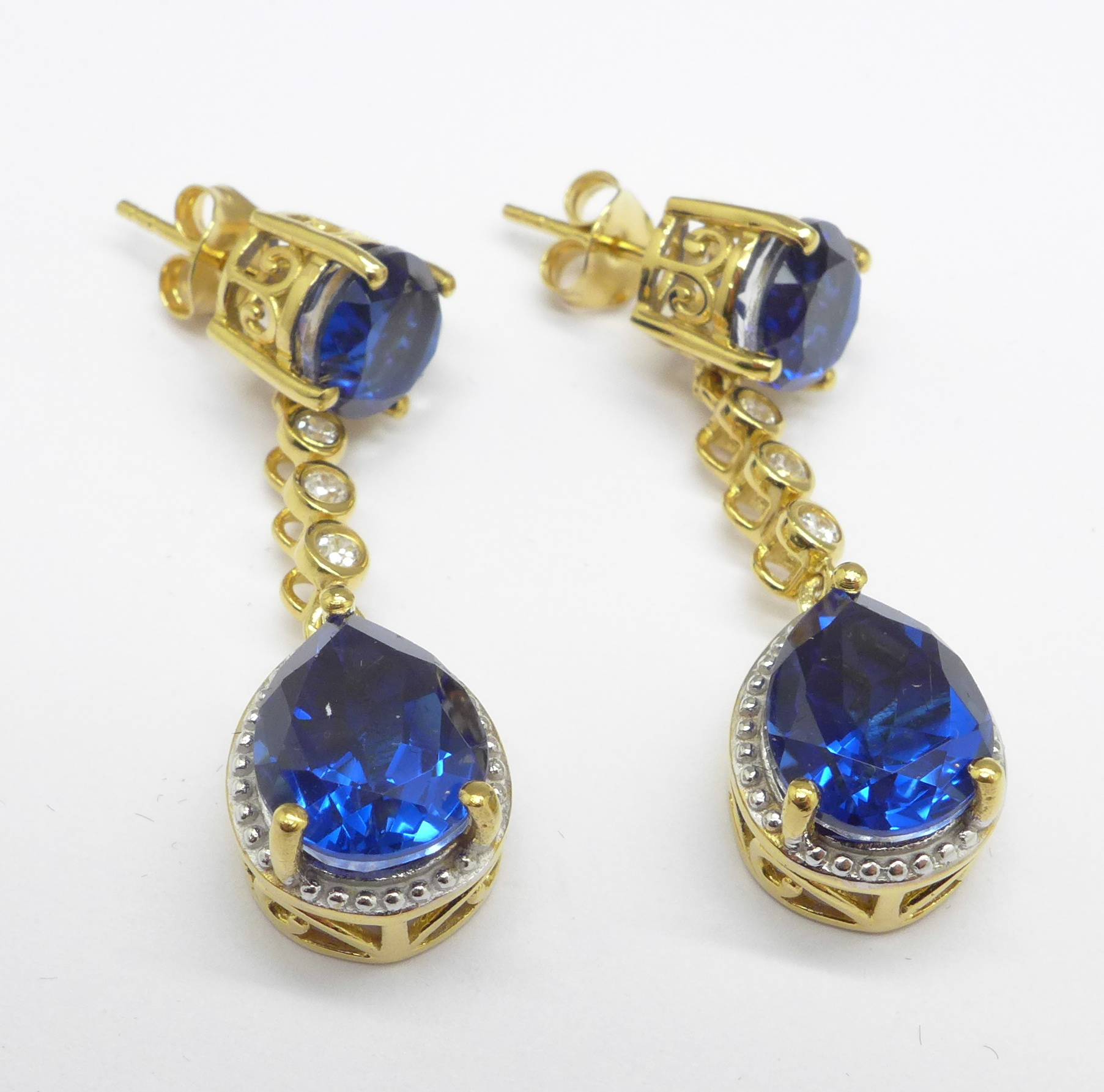 Lot 1006 - A pair of silver gilt earrings set with Cambodian zircon