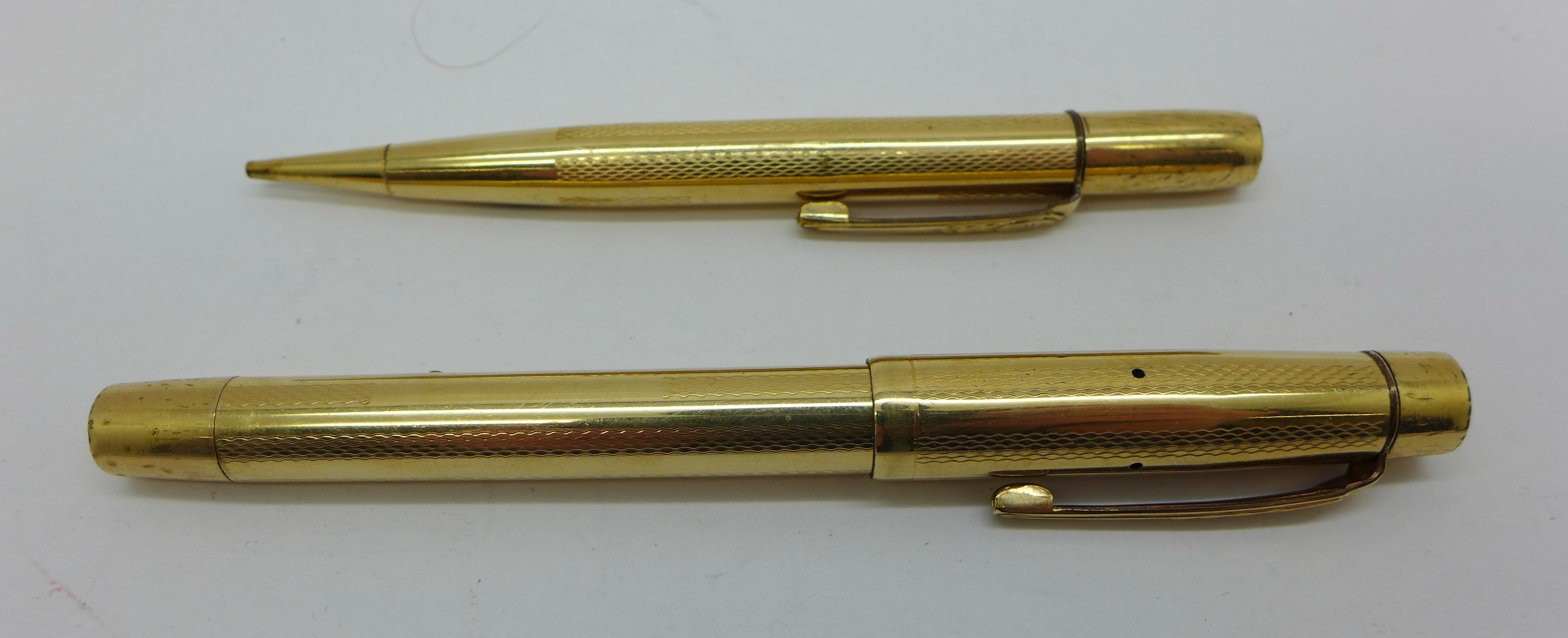 Lot 844 - A gold plated Onoto pen with 14ct gold nib and a matching pencil