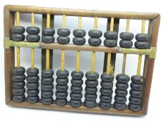 An early 20th Century Chinese Abacus, 26cm wide
