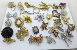 Approximately 30 costume brooches