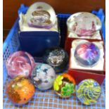 A collection of nine glass paperweights including one Langham