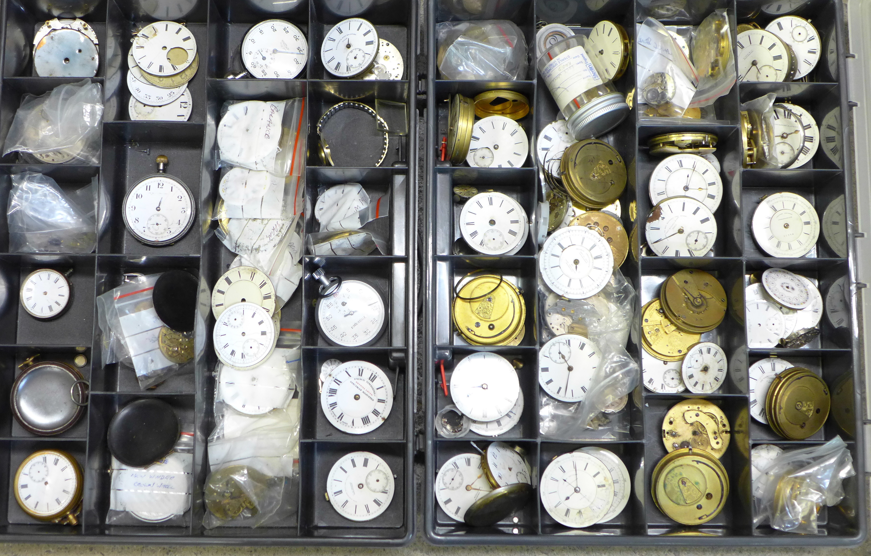 A large collection of pocket watch movements and dials plus an Action Timer stopwatch