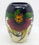 A Moorcroft vase, Anna Lily pattern, shape no. 102/5, by designer Nicola Slaney, 13cm
