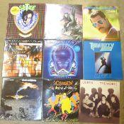 Twelve LP records, Queen, Thin Lizzy, Elvis Costello, Magnum