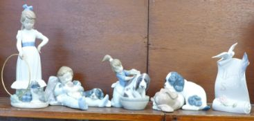 Two Lladro figures, Bashful Bather no. 5455 and Sweet Dreams no. 1535, and two Nao figures, My Dog