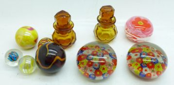 Five marbles including Victorian, two small amber glass scent bottles and three paperweights