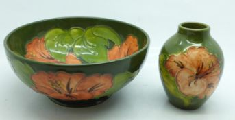 A Moorcroft bowl, diameter 16cm, and a vase, height 9.5cm, in the Coral Hisbiscus pattern on green