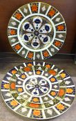 A pair of Royal Crown Derby 1128 Imari dinner plates, one other Royal Crown Derby plate and an