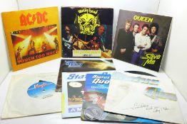 """Twelve 45rpm 7"""" singles, The Sex Pistols, AC/DC, Queen and Status Quo"""