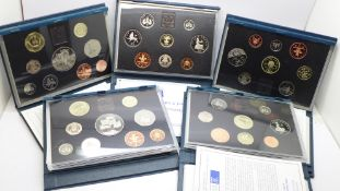 Five Royal Mint proof coin sets