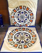 A pair of Royal Crown Derby 1128 pattern dinner plates, boxed