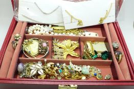 A jewellery box and contents including a 1970's Koret whistle necklace