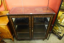 A Chinese carved display cabinet