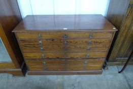 An early 20th century pitch pine six drawer plan chest