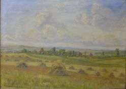 Continental School, harvest scene within an extensive landscape, oil on canvas, indistinctly signed,