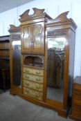 A Victorian carved walnut combination wardrobe