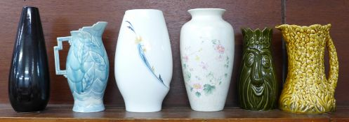 Six vases including Wedgwood, Poole and Sylvac, (blue and yellow jugs a/f)