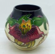 A Moorcroft vase (shape no. RM2/4) Anna Lily pattern by designer Nicola Slaney, 10cm