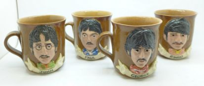 The Beatles, set of four mugs, each group member in Sgt. Pepper's outfits, 1970's