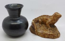 An early 20th Century fully black glazed vase and a model lizard, chip to the tail